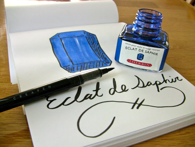 Ink review of J. Herbin Éclat de Saphir fountain pen ink, written with a J. Herbin blue glass dip pen.