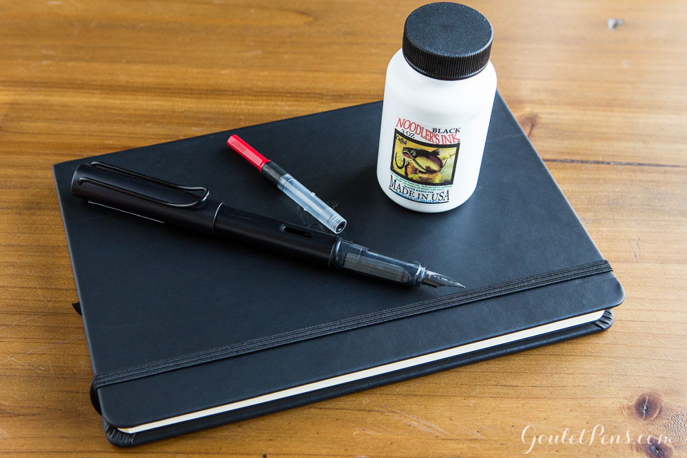 Black Lamy Al-Star Fountain Pen, Noodler's Black Ink, and Rhodia Webnotebook