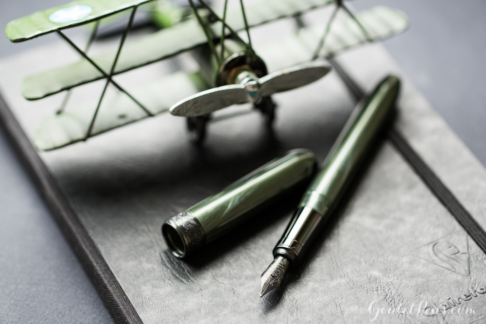 Visconti Special Ops Rembrandt alongside army green and stealthy black fountain pens, paper, and ink.
