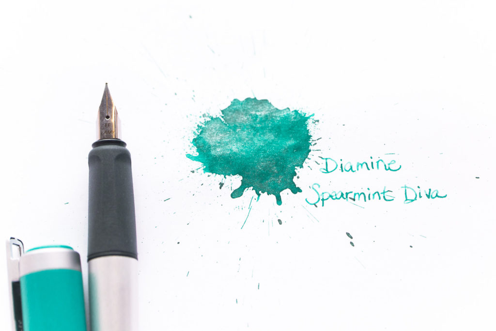 A Dr. Seuss quote and illustration drawn with Diamine Spearmint Diva n ink and a Lamy Nexx fountain pen.