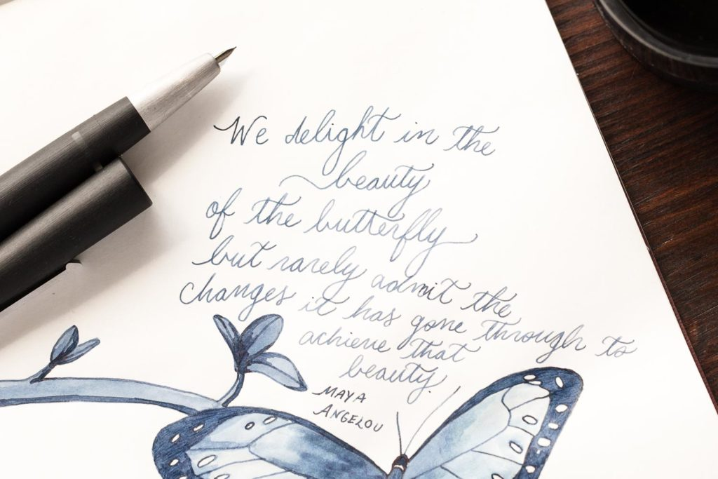 A quote by Maya Angelou featuring a butterfly using a Lamy 2000 fountain pen and Lamy Blue Black ink
