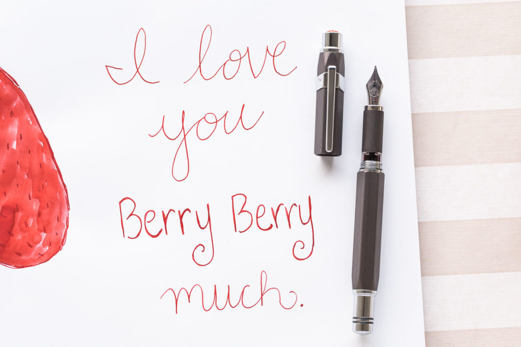 "Text reading ""I love you berry berry much"" with a drawing of a strawberry made using Diamine Wild Strawberry ink and a TWSBI Precision fountain pen."