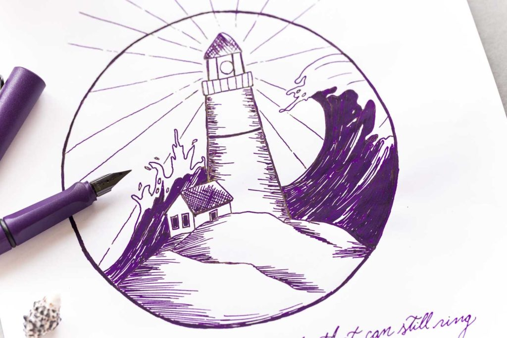 An illustration of a lighthouse with a quote by Leonard Cohen made using a Lamy Safari Dark Lilac fountain pen and Lamy Safari Dark Lilac ink.