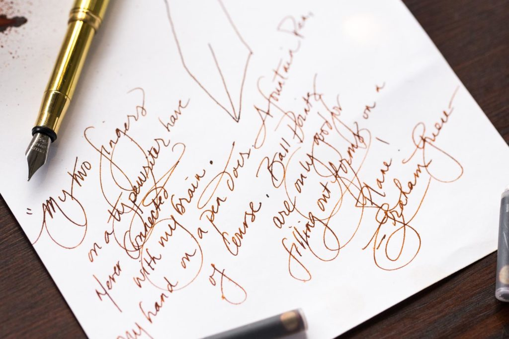 A fountain pen friendly quote by Graham Greene written with a Traveler's brass fountain pen and Monteverde Fireopal ink.