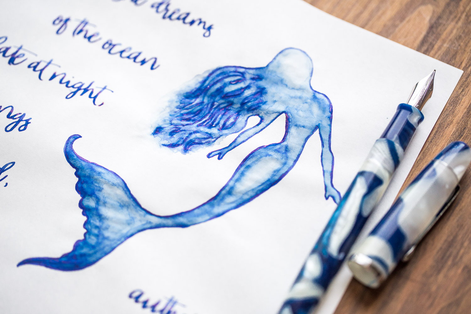 Drawing of a mermaid with a Noodler's Neponset Ghostly Lapis fountain pen and Nemosine Neptune Blue ink.