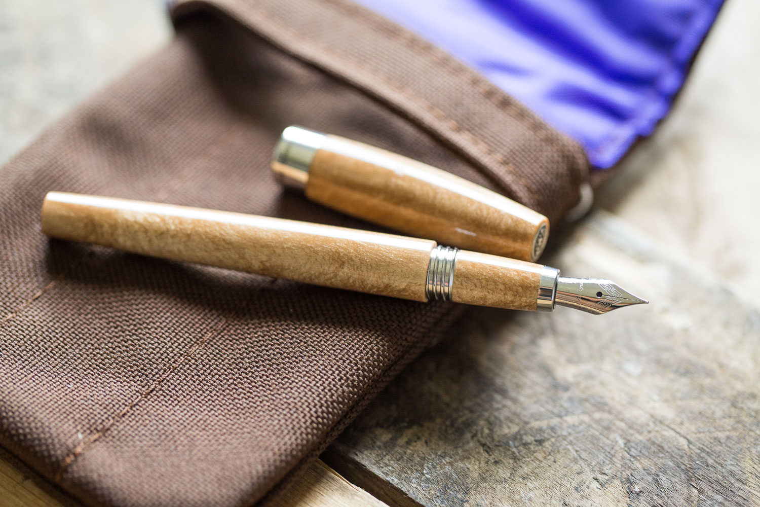 Montegrappa Felicita in a coffee and tea inspired flat lay of fountain pens, notebooks, and ink.