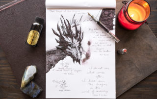 A drawing of a dragon featuring dragon quotes made with a TWSBI 580AL-R fountain pen and Robert Oster Smokescreen ink.