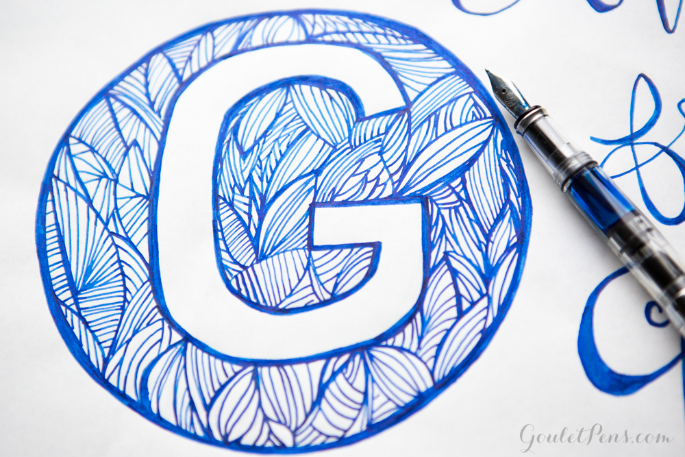 Handlettering illustration of the letter G with Noodler's Liberty's Elysium ink and a TWSBI Mini Clear fountain pen.