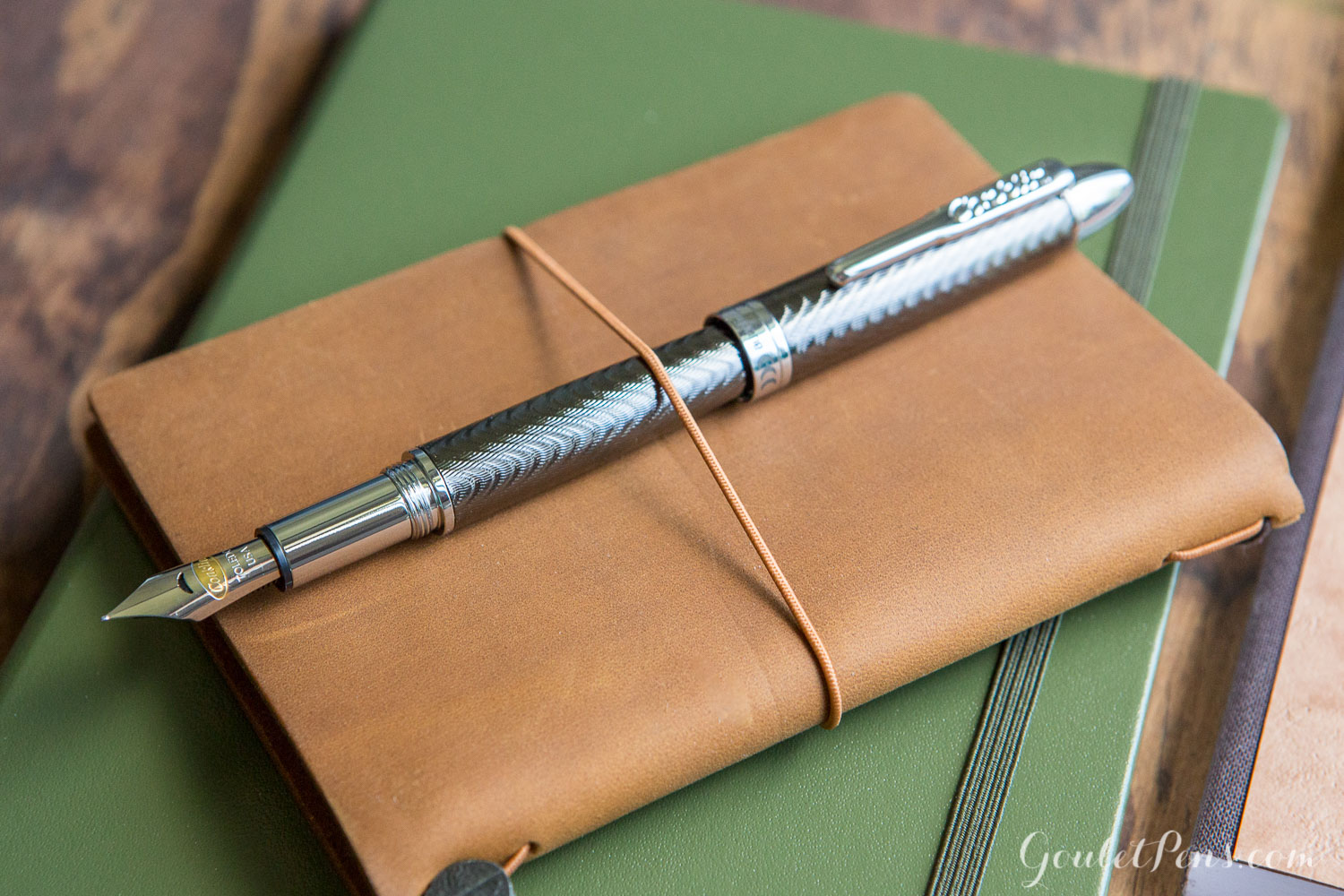 Father's Day inspired gifts in a flat lay of fountain pens, notebooks, and ink.