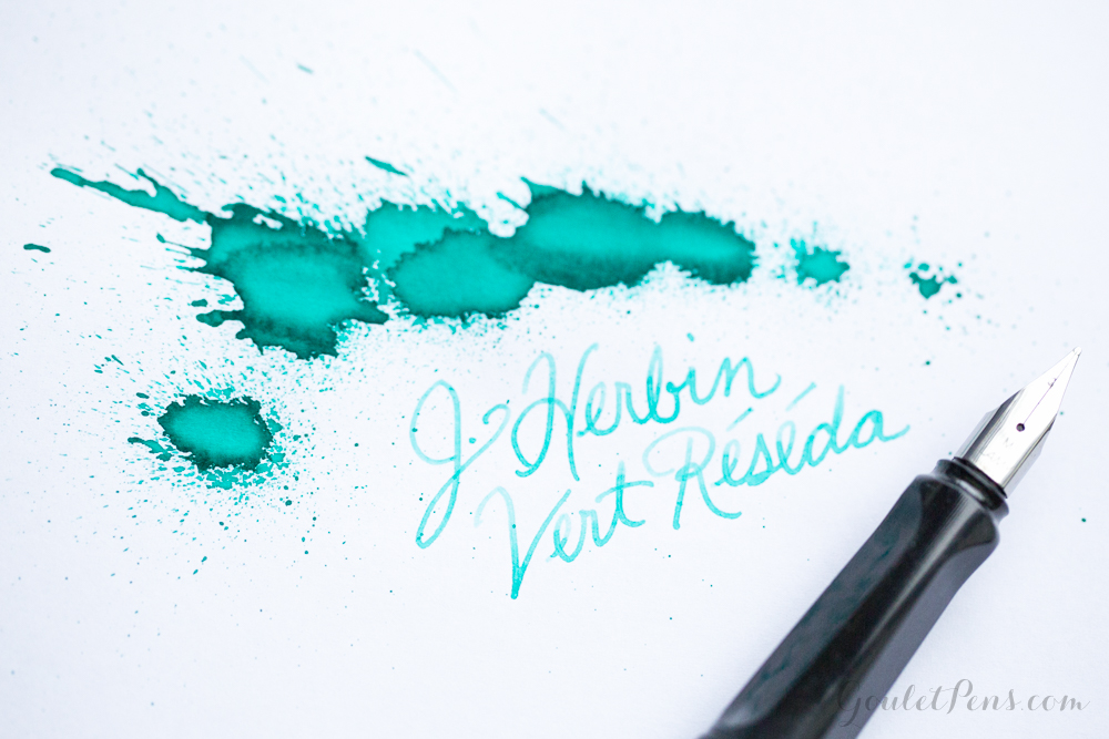 Ink splatter and handwriting J. Herbin Vert Réséda with a Lamy fountain pen.