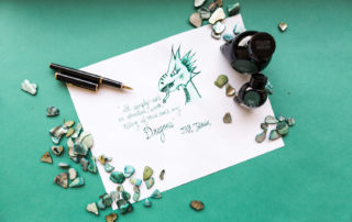 A dragon illustration and quote by J.R.R. Tolkein made using a Platinum PTL5000A fountain pen and Colorverse Laurel ink.