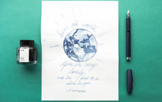 An illustration of the world featuring a quote by L.M. Montgomery. Made using a Faber Castell Essentio blue fountain pen and Kyo-No-Oto Aonibi ink.