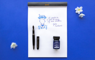 An illustration of Mary Poppins and a quote by Julie Andrews made using a Monteverde Mountains of the World Black fountain pen and Monteverde Special Edition D.C. Supershow Blue ink.