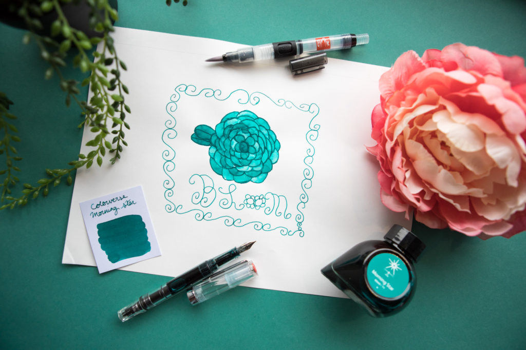 "A drawing of a flower with word ""bloom"" made using Colorverse Morning Star fountain pen ink and a TWSBI ECO fountain pen."
