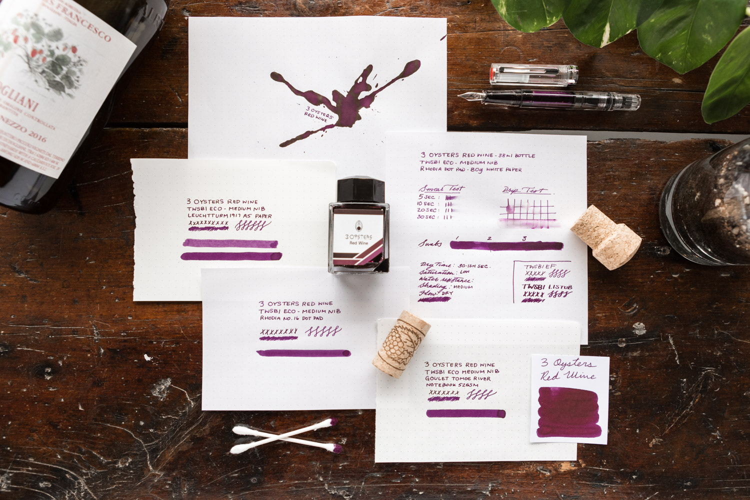 A layout of ink review materials for 3 Oysters Red Wine Ink.