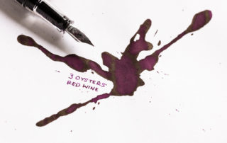 An ink splatter of 3 Oysters Red Wine ink