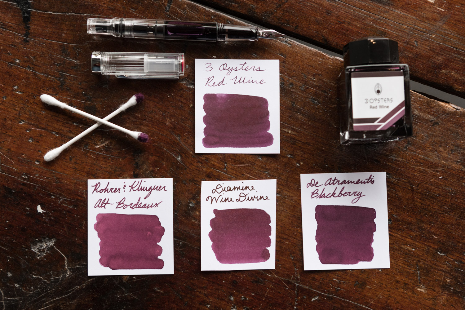 A layout of burgundy ink swabs comparable to 3 Oysters Red Wine ink.