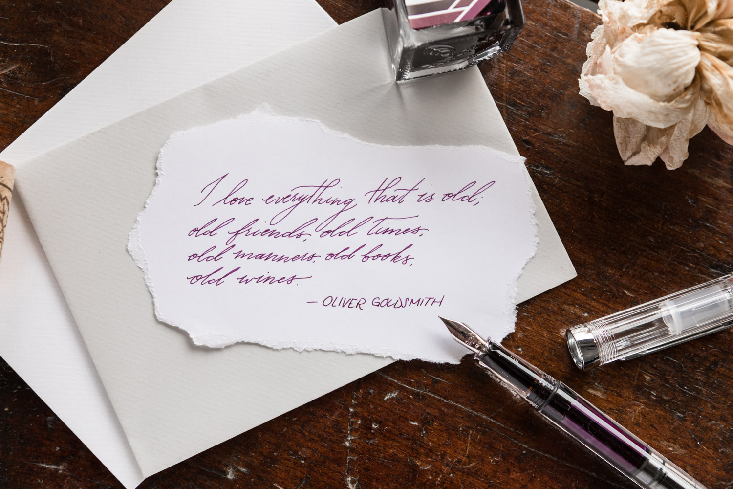 A quote by Oliver Goldsmith written with a TWSBI ECO fountain pen and 3 Oysters Red Wine ink.
