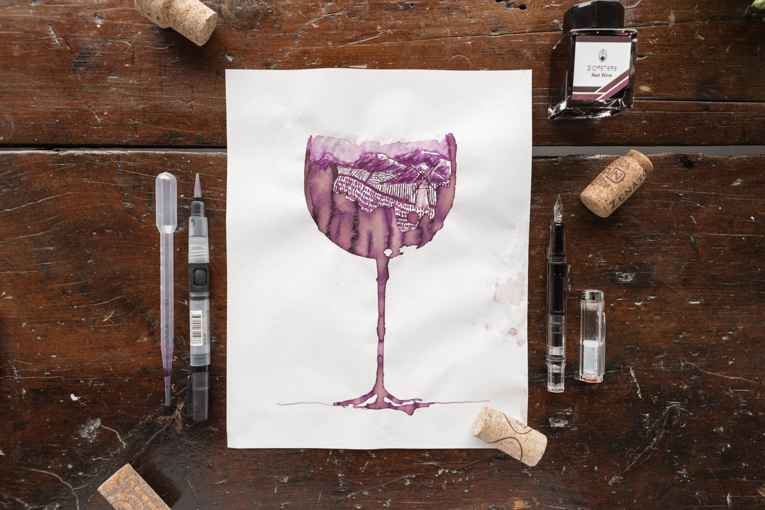A drawing of a wine glass and a vineyard made using 3 Oysters Red Wine Ink.