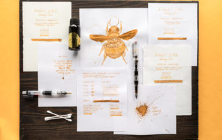 Collection of writing samples and drawings using Robert Oster Honey Bee Fountain Pen ink